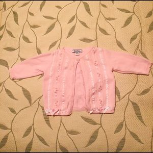 Pink button down sweater from Hartstrings